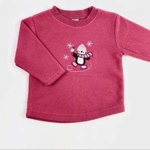 "Pink ""penguin"" sweater"